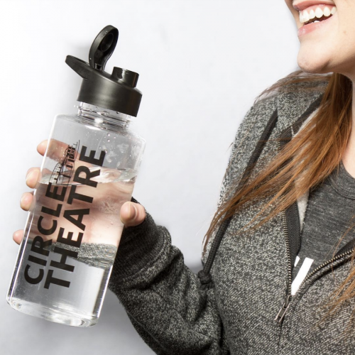 Circle Theatre Water Bottle being held by woman who's happy about it