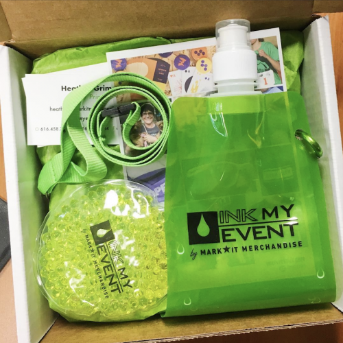 Ink My Event promotional products with water bottle, lanyard, and hot and cold pack