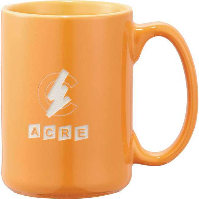 Bright orange ceramic mug available in different colors. Carved logo.