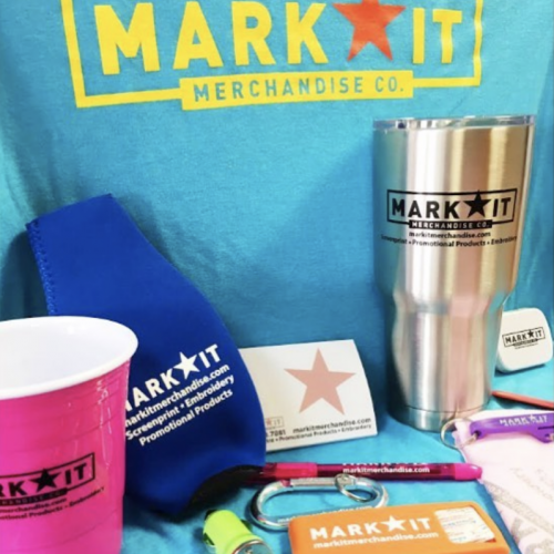 MarkIt Merchandise swag: koozies, stainless steel cup, notepads, pens, and bandaids.
