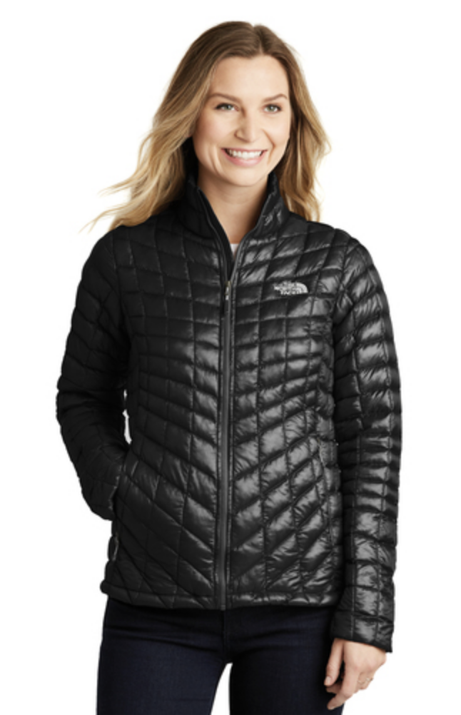 The North Face ladies thermoball trekker jacket. Featuring a woman wearing a black jacket.