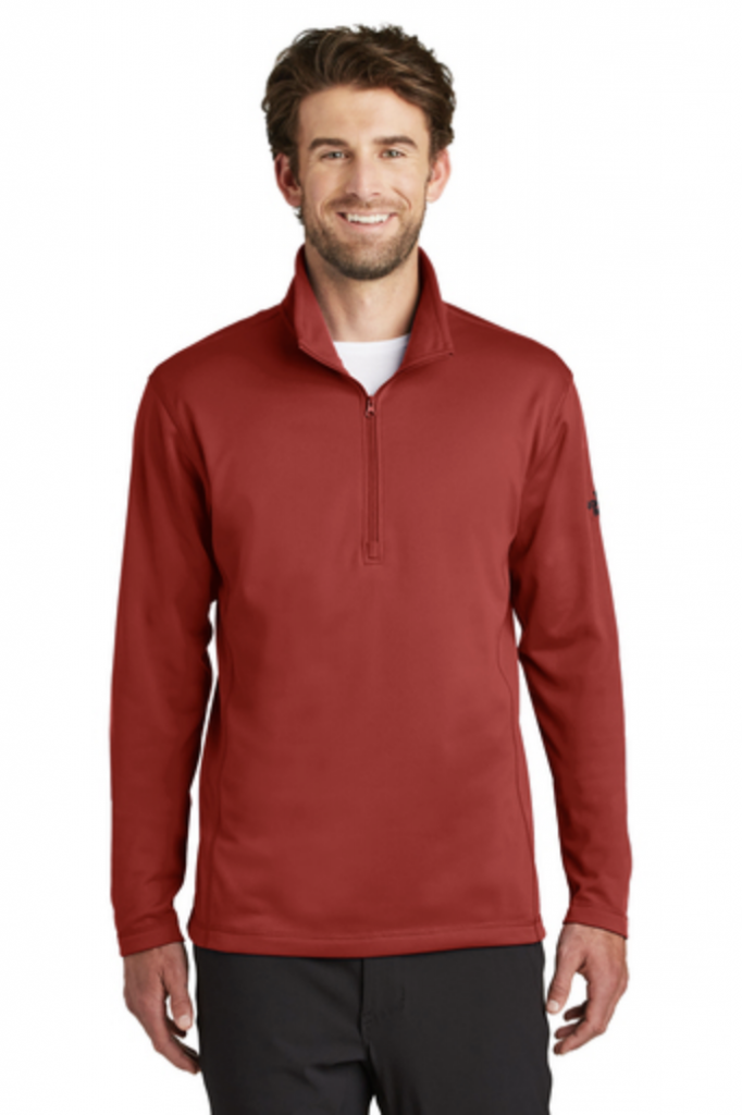 The North Face Tech 1:4-Zip Fleece in a Burnt Orange.