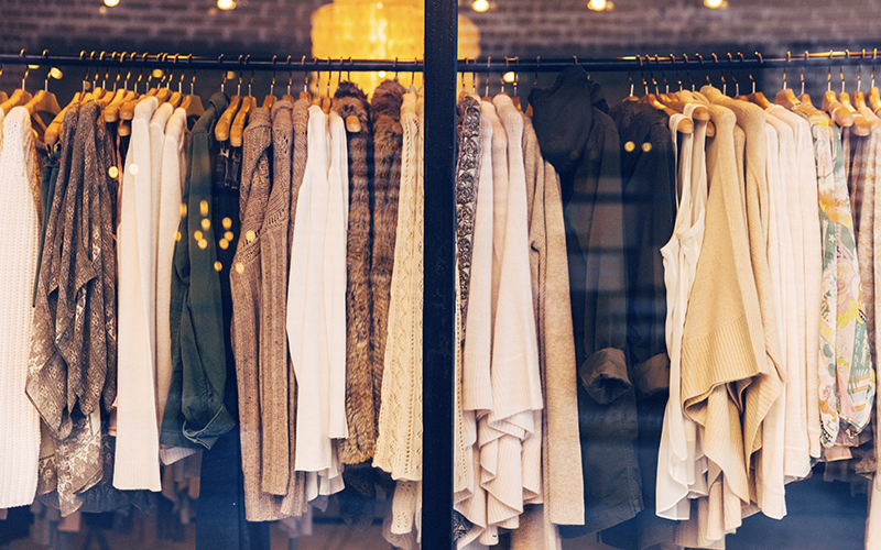 Garments hanging on rack, and featured in MarkIt Merchandise's blog.