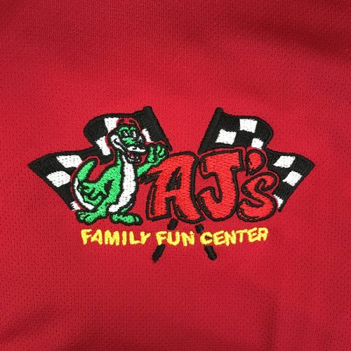 AJ's Family Fun Center Embroidery on red athletic polo, embroidered at MarkIt Merchandise.