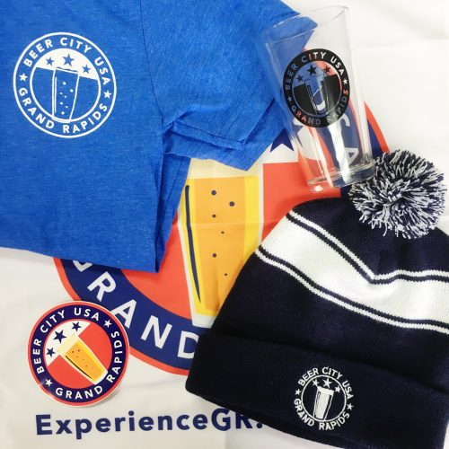 Beer City USA promotional products featuring a hat, glass, t-shirt, banner and sticker.