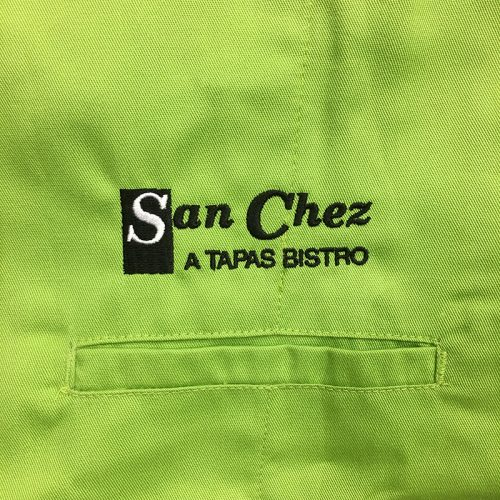 San Chez A Tapas Bistro Embroidery on lime green chef coat. Embroidered at MarkIt Merchandise.